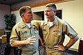 US Navy 090428-N-9818V-017 Master Chief Petty Officer of the Navy (MCPON) Rick West speaks with Chief of Navy Chaplains Rear Adm. Robert F. Burt before kicking off the Individual Agumentee Symposium at Naval Base Kitsap Bangor.jpg