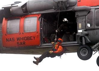Naval aircrewman - AIRR performing a mountain rescue