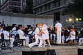 US Navy 090623-N-0303C-045 Musician 1st Class Rachel Sarracco, right, and Musician 1st Class William Edwards, left, sing at the U.S. Navy Memorial during a free summer.jpg