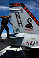 US Navy 090819-N-1245S-006 Aviation Machinist's Mate 3rd Class Joshua Brock, assigned to the Sidewinders of Strike Fighter squadron of (VFA) 86, cleans an F-A18C Hornet aboard the aircraft carrier USS Nimitz.jpg