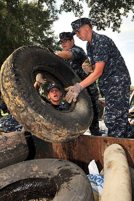 Naval Nuclear Power Training Command student volunteers remove and dispose of used tires littering the waterways of Naval Weapons Station Charleston, South Carolina. US Navy 090917-N-1783P-001 Naval Nuclear Power Training Command student volunteers dispose of used tires littering the waterways of Naval Weapons Station Charleston.jpg