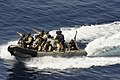 US Navy 091112-N-9500T-121 A visit, board, search and seizure team from the guided-missile cruiser USS Chosin (CG 65) point to a suspected pirate dhow as they make their approach to board it during counter-piracy operations in.jpg