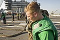 US Navy 091117-N-2953W-009 Interior Communications Electrician 2nd Class Shawn Magoon tows barricade webbing.jpg
