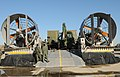 US Navy 100114-N-5787K-002 Seabees assigned to Amphibious Construction Battalion (ACB) 2 load vehicles and equipment onto landing craft air cushion vehicles to support Operation Unified Response.jpg