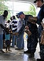 US Navy 100130-N-5244H-058 A Haitian boy receives a meal-ready-to-eat (MRE) from Sailors assigned to the dock-landing ship USS Carter Hall (LSD 50) at a Birey, Haiti school.jpg