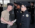 US Navy 100313-N-8848T-331 Aviation Structural Mechanic 1st Class Ken Snider, left, a recruit division commander at Recruit Training Command, inspects cadets from Taft High School in Chicago.jpg
