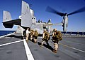 US Navy 100415-N-2147L-001 Marines assigned to India Company, 3rd Battalion, 9th Marine Regiment board an MV-22 Osprey aboard the amphibious transport dock ship USS New York (LPD 21).jpg