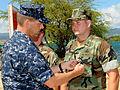 US Navy 100514-N-3666S-052 Rear Adm. Dixon Smith presents the Bronze Star medal to Explosive Ordnance Disposal Technician 1st Class Robert Moses.jpg