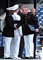 US Navy 100528-N-3857R-289 A Marine Corps graduate is congratulated by a fellow Marine after receiving his diploma during the U.S. Naval Academy Class of 2010 graduation and commissioning ceremony.jpg