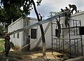 US Navy 100729-N-4153W-381 Seabees assigned to Construction Battalion Mobile Unit (CBMU) 202 and Naval Mobile Construction Battalion (NMCB) 7 build a new roof on a hospital in Port-de-Paix, Haiti.jpg