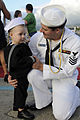 US Navy 101029-N-3560G-002 Machinist Mate 1st Class Steven Bear hugs his son during a homecoming celebration for the Los Angeles-class submarine US.jpg
