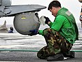 US Navy 110324-N-KB563-834 Aviation Electronics Technician Airman Robert Hunter cleans a forward looking infrared camera on an MH-60S Sea Hawk heli.jpg
