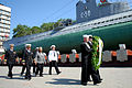 US Navy 110704-N-MU720-074 Sailors carry a ceremonial wreath ahead of the official party during a wreath laying ceremony in Vladivostok, Russia.jpg
