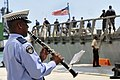 US Navy 110905-N-IZ292-190 A member of the Mauritian Police Force Band plays the clarinet as the guided-missile frigate USS Samuel B. Roberts (FFG.jpg