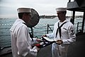 US Navy 111014-N-RB564-011 Seaman Apprentice Stephen Carr, left, and Cryptologic Technician 3rd Class Jacob Blackwell, fold the national ensign dur.jpg