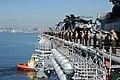 US Navy 111114-N-UE944-141 Sailors and Marines man the rails aboard the amphibious assault ship USS Makin Island (LHD 8) as the ship departs San Di.jpg