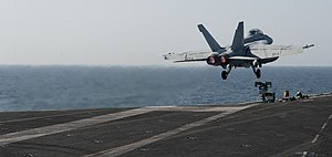 US Navy 120104-N-OY799-094 An F-A-18F Super Hornet from the Black Aces of Strike Fighter Squadron (VFA) 41 launches from the Nimitz-class aircraft.jpg