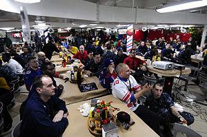 US Navy 120206-N-MD252-308 Sailors watch Super Bowl XLVI aboard the Nimitz-class aircraft carrier USS Carl Vinson (CVN 70).jpg