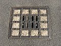 Utility access cover, St Jude's Church, Hampstead Garden Suburb, London NW11.jpg