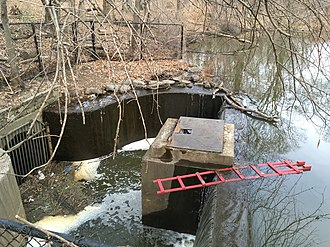 The lake flows south into a drain pipe to the Broadway sewer VCP Lake outlet.jpg