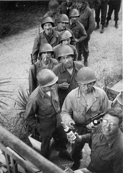 File:VE Day Passing out Champagne to 1139th troops.jpg