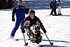 Sgt. Anthony Larson, his adaptive ski instructor close behind, skis down the beginner's hill on his mono-ski March 9 in Vail, Colo. Larson lost his right leg below the knee while serving in Iraq.