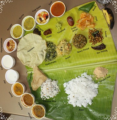 A traditional meal served on a banana leaf Veg Full Meals in Tamil Nadu.JPG