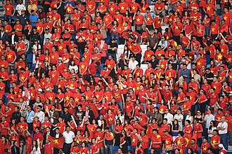 Vietnam national football team - Vietnamese supporters during the 2019 AFC Asian Cup in all red and yellow star dress similar as in the colour of the flag of Vietnam.