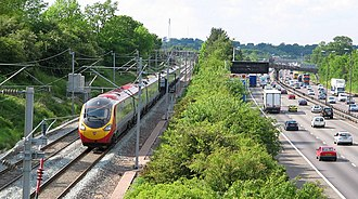 Transport in the United Kingdom - The West Coast Main Line railway, alongside the M1 motorway