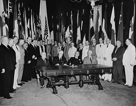 Washington, D.C. Representatives of 26 United Nations at Flag day ceremonies in the White House to reaffirm their pact. Seated, left to right: Francisco Castillo Najera, Ambassador of Mexico; President Roosevelt; Manuel Quezon, President of the Philippine Islands; and Secretary of State Cordell Hull. Washington, D.C. Representatives of 26 United Nations at Flag day ceremonies in the White House to reaffirm their pact.jpg