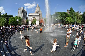 Washington Square Park - Visitors wading in the fountain