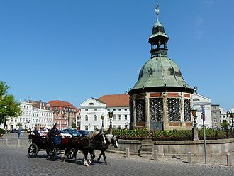 Wismar - Market Square with the waterworks from 1602 (Wasserkunst), landmark of Wismar