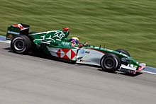 Webber driving his green Jaguar R5 at the 2004 United States Grand Prix at Indianapolis Motor Speedway