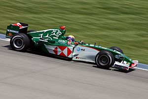 The 2004 Jaguar car, being driven by Mark Webber.