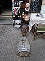 Wine bottles, statues, barrel at 22 Dobó Street, Eger, 2016 Hungary.jpg