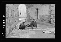 Women of Bethlehem grinding in courtyard before their home LOC matpc.18967.jpg