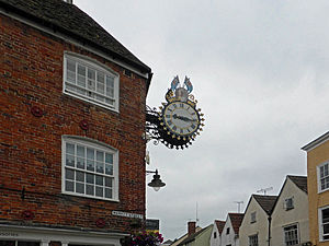 "Diamond jubilee - The Tolsey clock commemorates the Diamond Jubilee (60 years) of Queen Victoria's reign. The clock says ""1837 – 1897"". It lies between Market Street and High Street in Wotton-under-Edge, Gloucestershire, England."