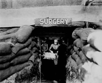 Battlefield medicine - A US Army soldier, wounded by a Japanese sniper, undergoes surgery during the Bougainville Campaign in World War II.