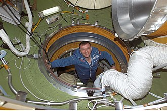 Yuri Gidzenko - Soyuz 4 Taxi Commander Gidzenko enters the Zaryas pressurized adapter on the ISS.