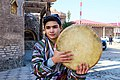Young Tajik twink in national clothes and a Doyra musical instrument in Samarkand (Uzbekistan).jpg
