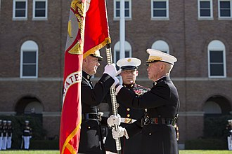 James F. Amos - Amos exchanges the Battle Colors of the Marine Corps with incoming Commandant General Joseph Dunford on October 17, 2014