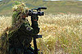 070424-N-AA606-007.CAMP PENDLETON, Calif. (April 24, 2007) - A combat videographer practices evasion techniques while on a mock patrol during Quick Shot 2007. Quick Shot is a semi-annual field exercise hosted 070424-N-AA606-007.jpg