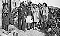 083 1942 - Joe ^ Marie's family in Tripoli, Syria (Tom's gf Mary 3rd from R).jpg