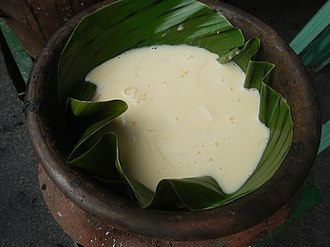 Rice flour - Filipino galapóng, a viscous rice flour dough made by grinding glutinous rice soaked overnight, shown being baked into bibingka