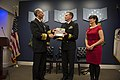 121127-N-WL435-082 Chief of Naval Operations (CNO) Adm. Jonathan Greenert presents the Vice Adm. James Bond Stockdale Leadership Award to Cmdr. Brian Sittlow.jpg