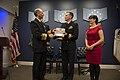 121127-N-WL435-082 Chief of Naval Operations (CNO) Adm. Jonathan Greenert presents the Vice Adm. James Bond Stockdale Leadership Award to Cmdr. Brian Sittlow.jpg