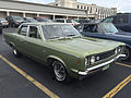 1969 AMC Rebel SST 4-door sedan in green at 2015 AMO show 1of6.jpg
