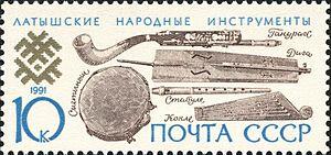 Ģīga - Postage stamp showing Latvian traditional instruments, amongst those the ģīga