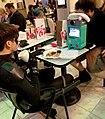 2014 Dragon Con - Nightwing playing BMO (14936904480).jpg