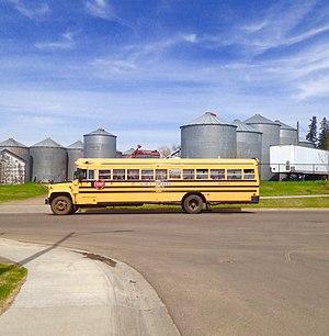 2018-05-14 Blue Bird school bus with GMC chassis, Spruce Grove, AB.jpg